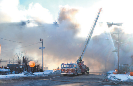 Photos by Ron Jeffers Freezing conditions hampered firefighters as they fought a fire at Kephart Trucking on Second St.