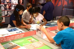 Children browse the exhibits at the New Jersey Hall of Fame Mobile Museum.