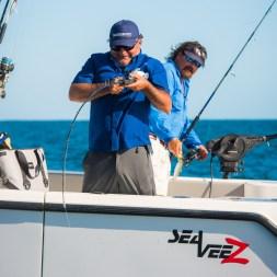 Julio Meza reeling in grouper