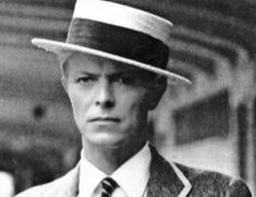 bowie in buster hat