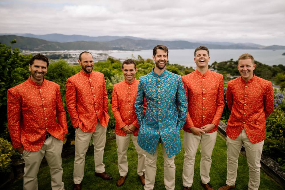 Western Indian fusion wedding day with groom and groomsmen in traditional Sherwani