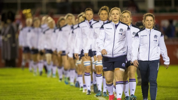 Scotland captain Lisa Martin leads her team out against Wales