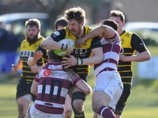 Melrose flanker Iain Moody is tackled by Rory Hutton and Sean Crombie
