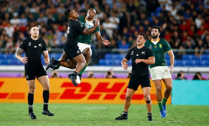 Sevu Reece of New Zealand and Makazole Mapimpi of South Africa jump for the high ball during their Rugby World Cup Pool B match. Image: Fotosport / David Gibson