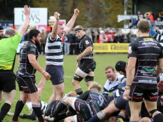 Heriot's players celebrate a try by lock Ronan Seydak. Image: Fotosport/David Gibson