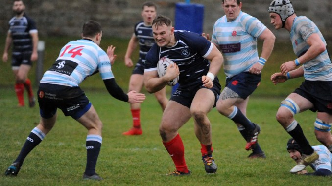 Musselburgh prop Sam Grahamslaw takes on Edinburgh Accies winger Fraser Lindsay. Image: Fotosport/David Gibson