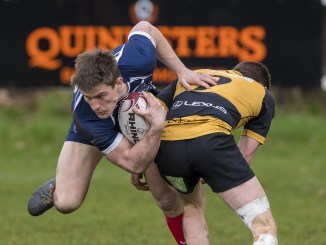 Musselburgh's Rory Watt is tackled by Gregor Christie in a thriller at Stoneyhill. Image: © Craig Watson - www.craigwatson.co.uk