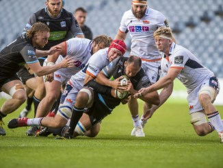 Glasgow Warriors second-row Kiran McDonald is tackled by Grant Gilchrist of Edinburgh. Image: ©Craig Watson