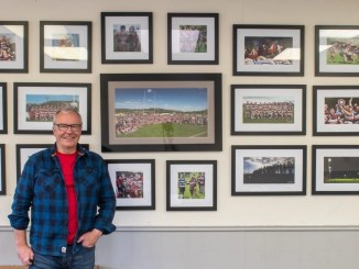 Bryan Robertson in front of the Spirit of Stirling County Wall