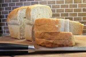 Fresh sliced bread on cutting board