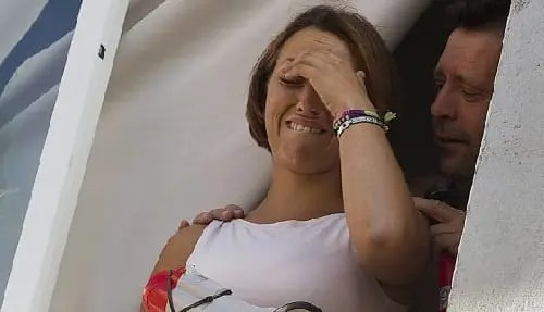 A woman breaks down in tears after she learns she will not be evicted from her home...yet.