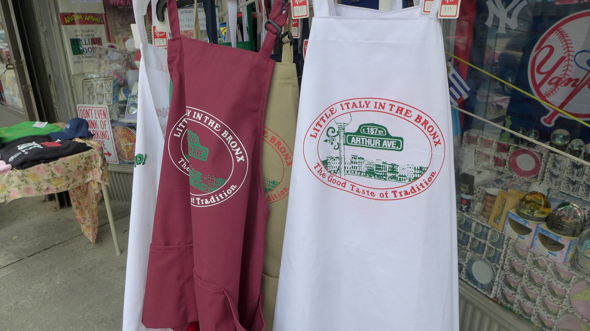 aprons hanging outside a market on Arthur Avenue in the Bronx.
