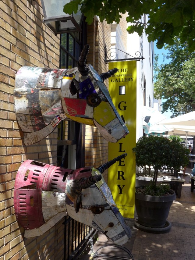 Two cow head sculptures on Dorp Street in downtown Stellenbosch, home of South African wine tour