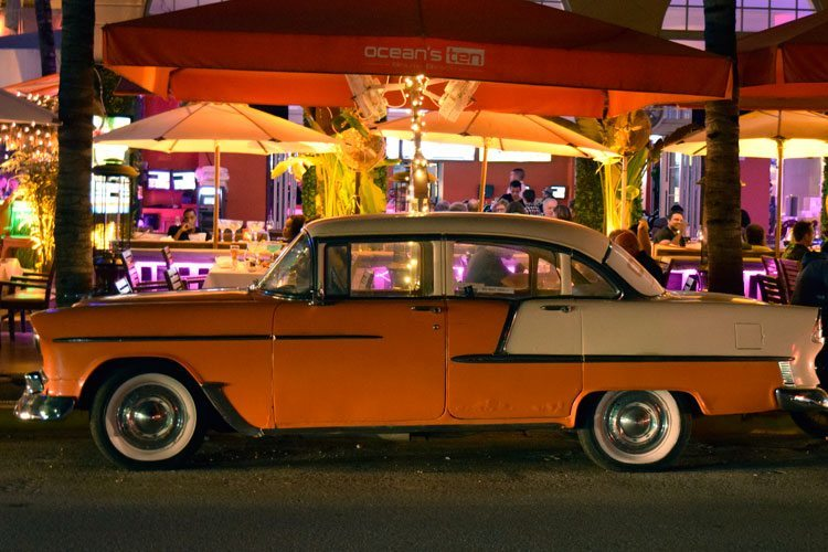 A classic car parked on Ocean Drive in South Beach Miami, one of the best places to visit
