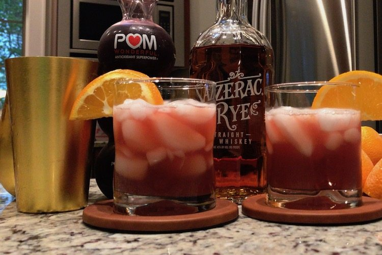 two rye father's day whiskey cocktails with orange slice garnish