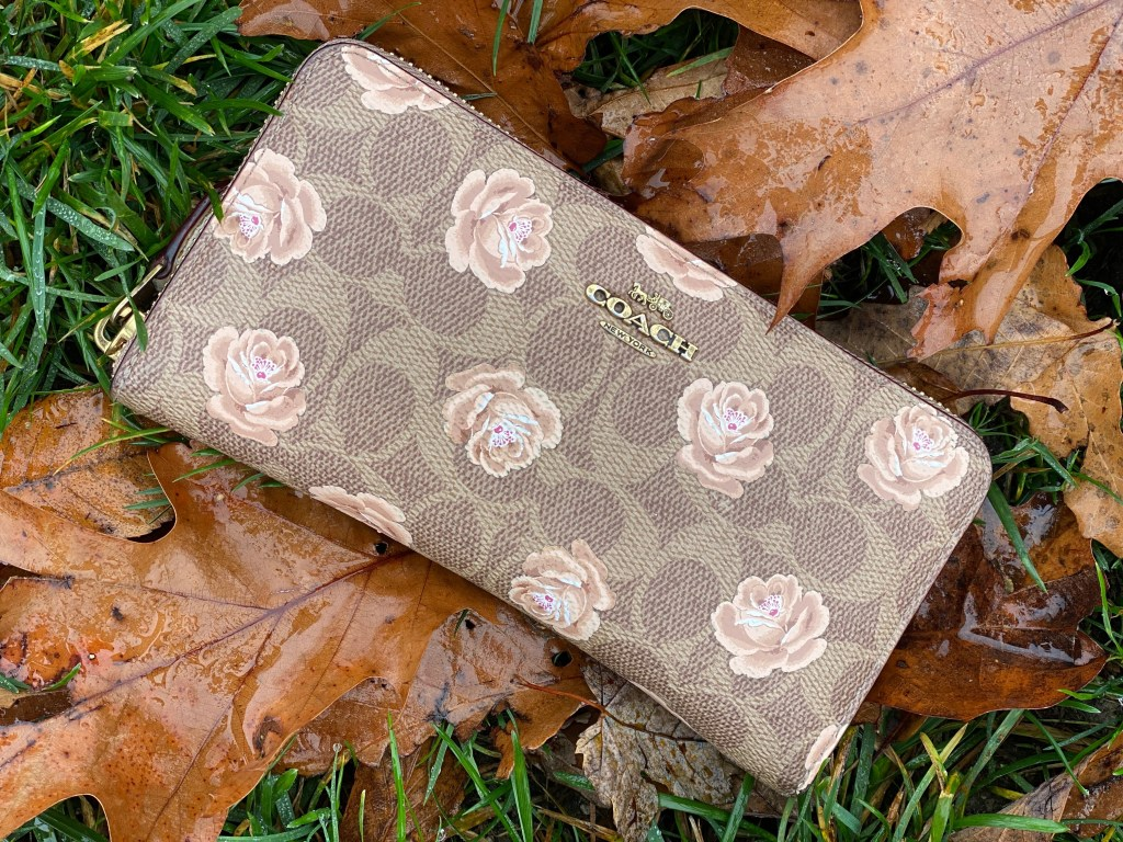 coach floral wallet in leaves