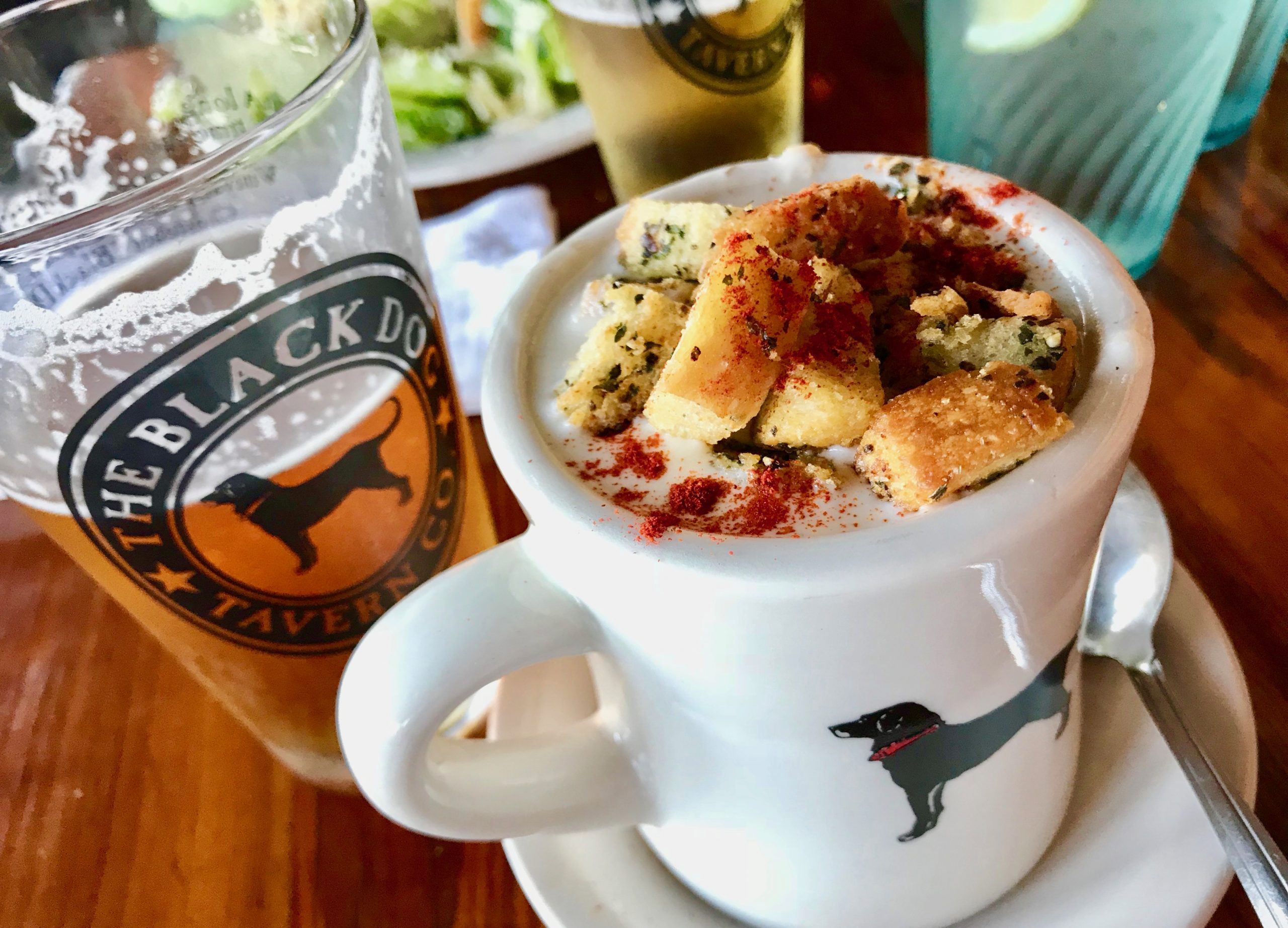 mug of clam chowder and a beer at Martha's Vineyard famous restaurant The Black Dog
