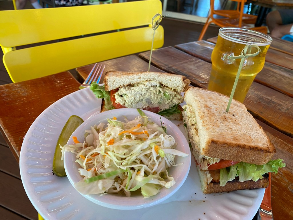 chicken salad sandwich, coleslaw, pickle and a beer