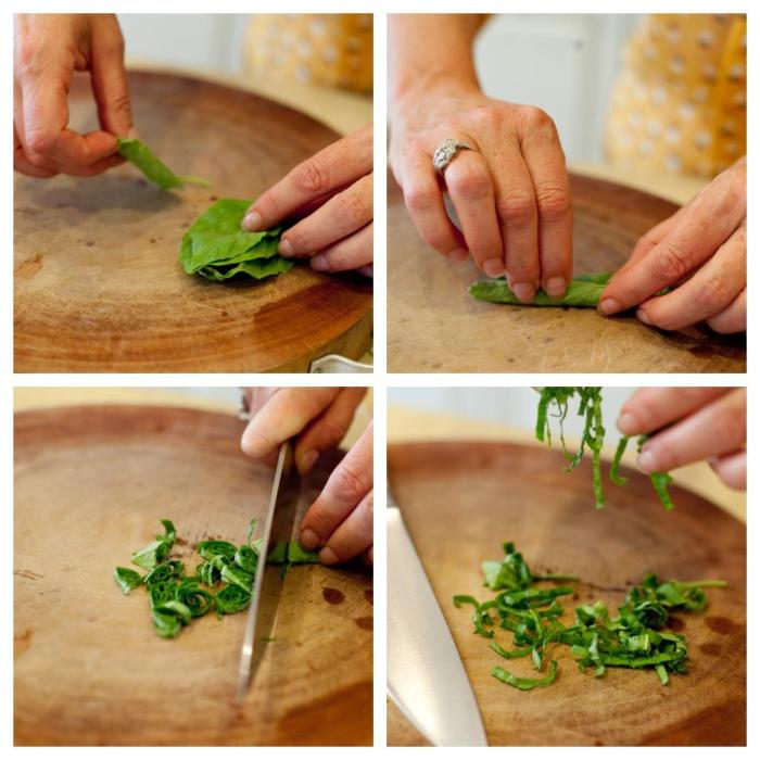 A series of four photos showing how to chiffonade basil to be used a garnish for Linguini with Chicken and Goat Cheese
