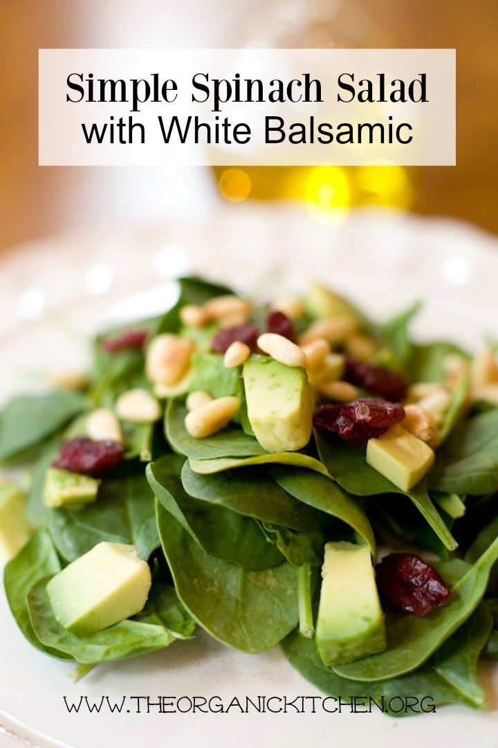 Simple Spinach Salad with White Balsamic on a white plate