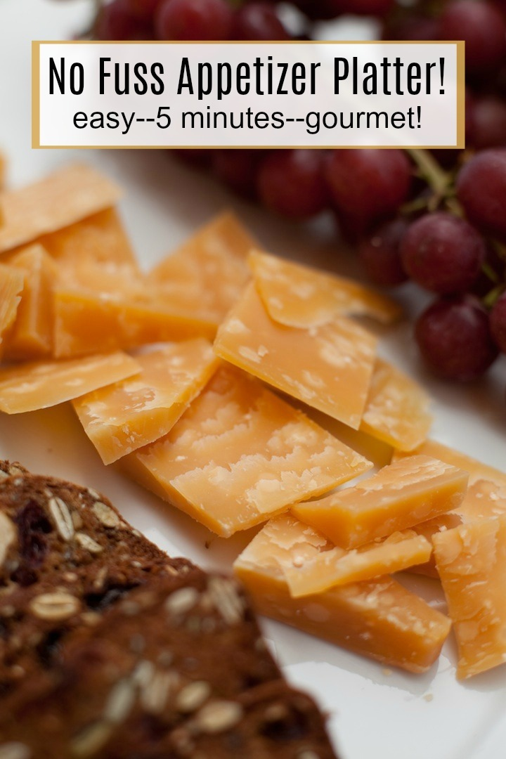 Cheese, grapes and crackers on a white plate: No Fuss Appetizer Platter