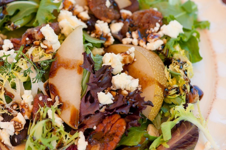 """A close up of """"Greens with Asian Pears and Fig/Maple Balsamic Vinaigrette"""""""