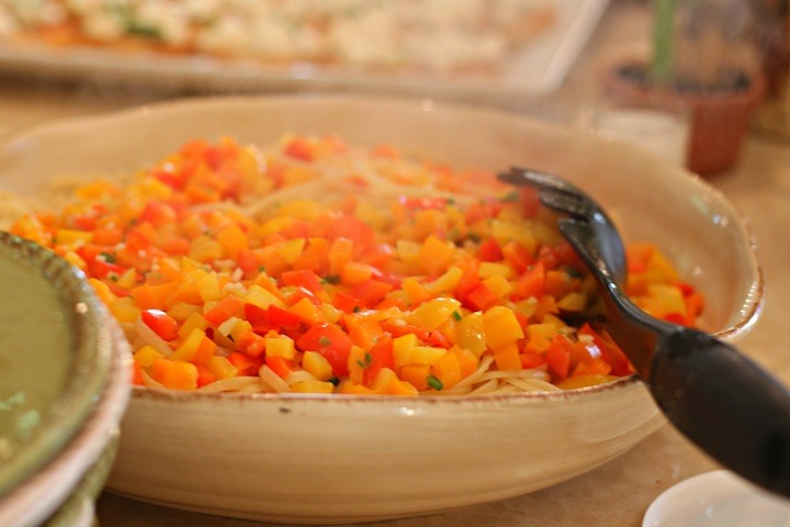 Linguini with Sweet Bell Peppers and Serrano Chili in a large cream colored bowl