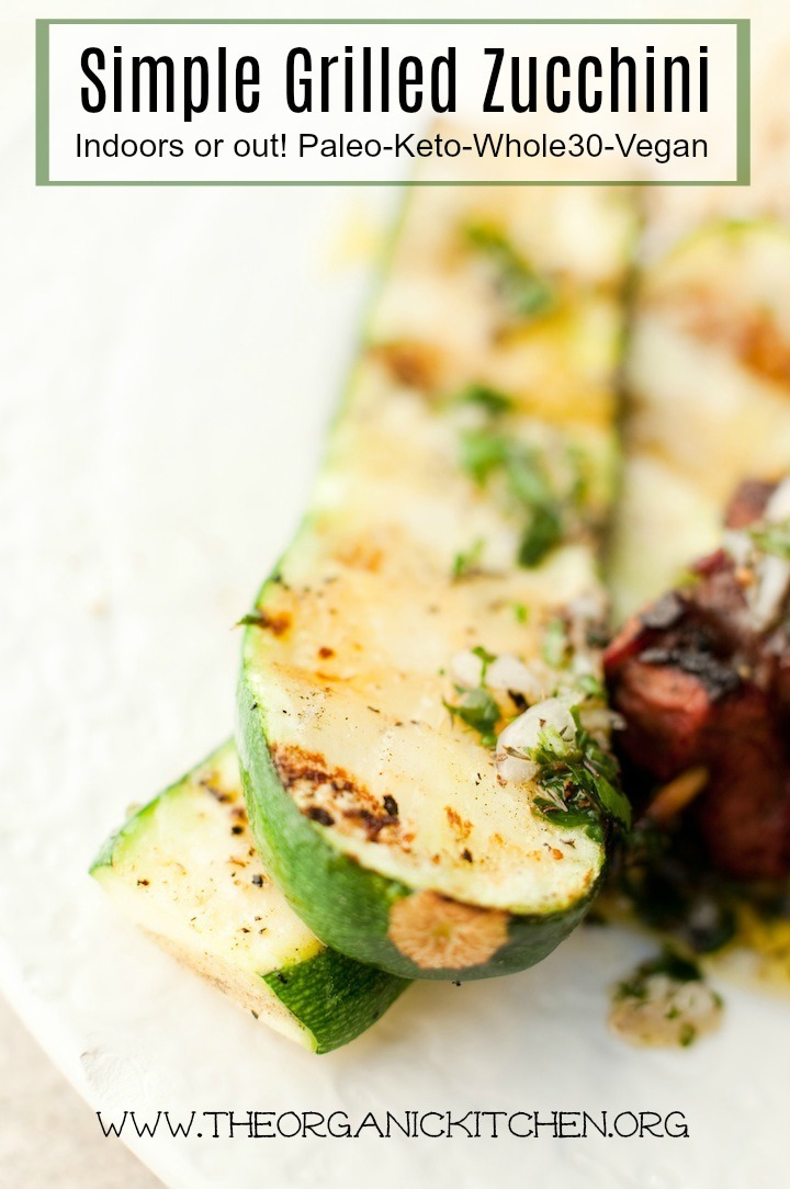 A close up of Simple Grilled Zucchini on a white plate