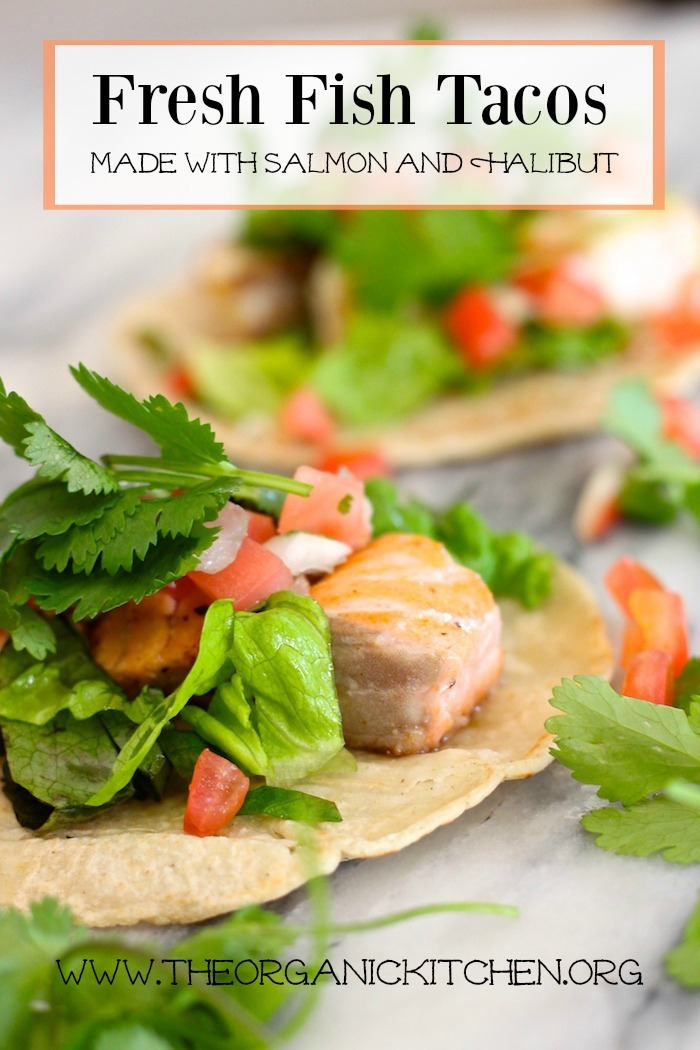 Fresh Fish Tacos garnished with lettuce, cilantro and pico de gallo on marble board