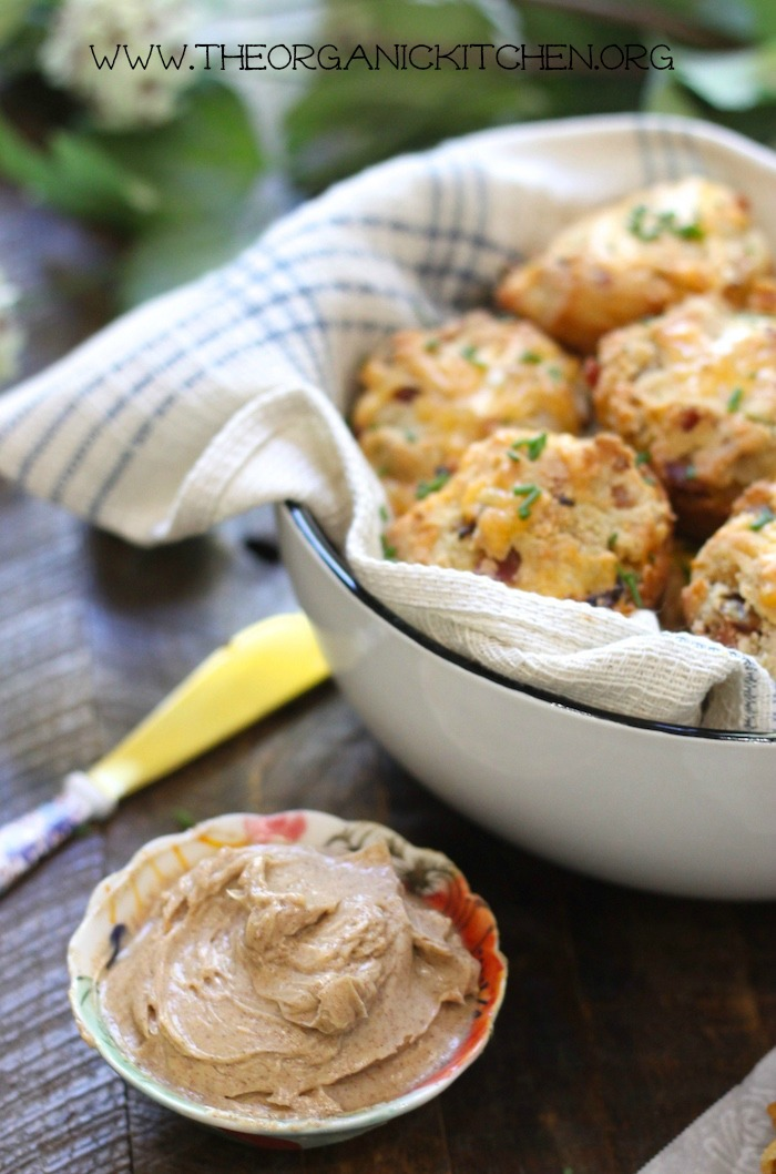 Cheddar Bacon Biscuits with Maple Cinnamon Butter in bowls on a wood surface