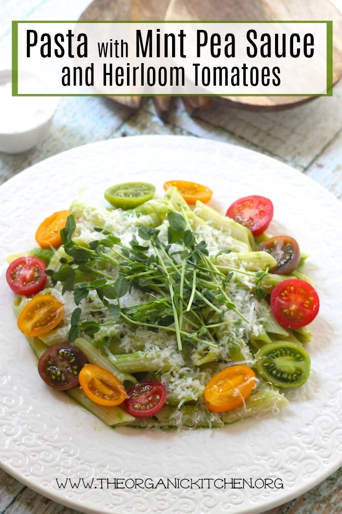 Pasta with Mint Pea Sauce and Heirloom Tomatoes on a white plate