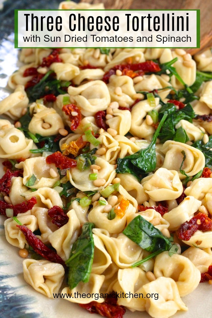 Three Cheese Tortellini with Spinach and Sun Dried Tomatoes on a platter