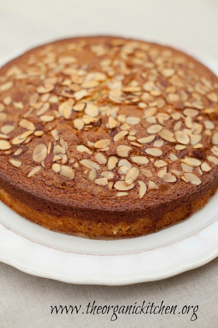 Traditional Olive Oil Cake topped with sliced almonds from The Organic Kitchen