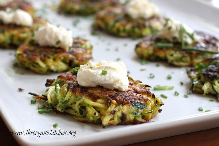Crispy Zucchini Fritters with Lemon Ricotta (with Gluten Free Option) on a white platter