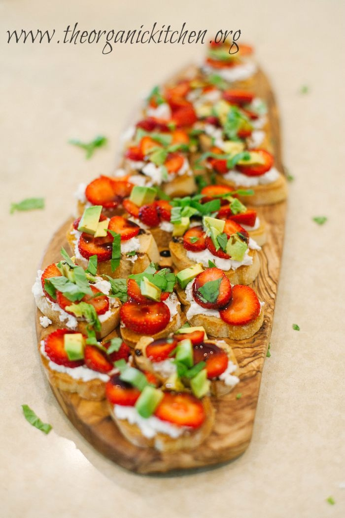 A platter of Strawberry and Avocado Bruschetta garnished with basil and balsamic glaze