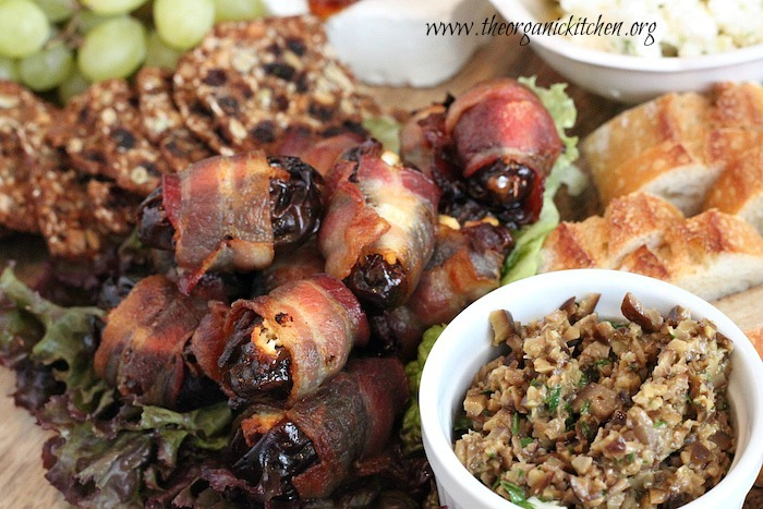 This is THE ultimate Mediterranean appetizer platter! It includes amazing spiced up cheeses like gouda and feta along with hummus, tapenade and bacon wrapped dates! It's perfect for your next dinner party.