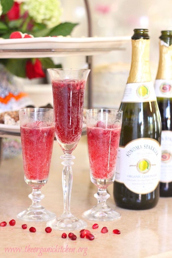 This citrus sparkler is the perfect non-alcoholic party drink! It includes options for a raspberry lemon sparkler and a pomegranate blood orange sparkler, using sorbet in a Bellini style drink worthy of a fancy glass.