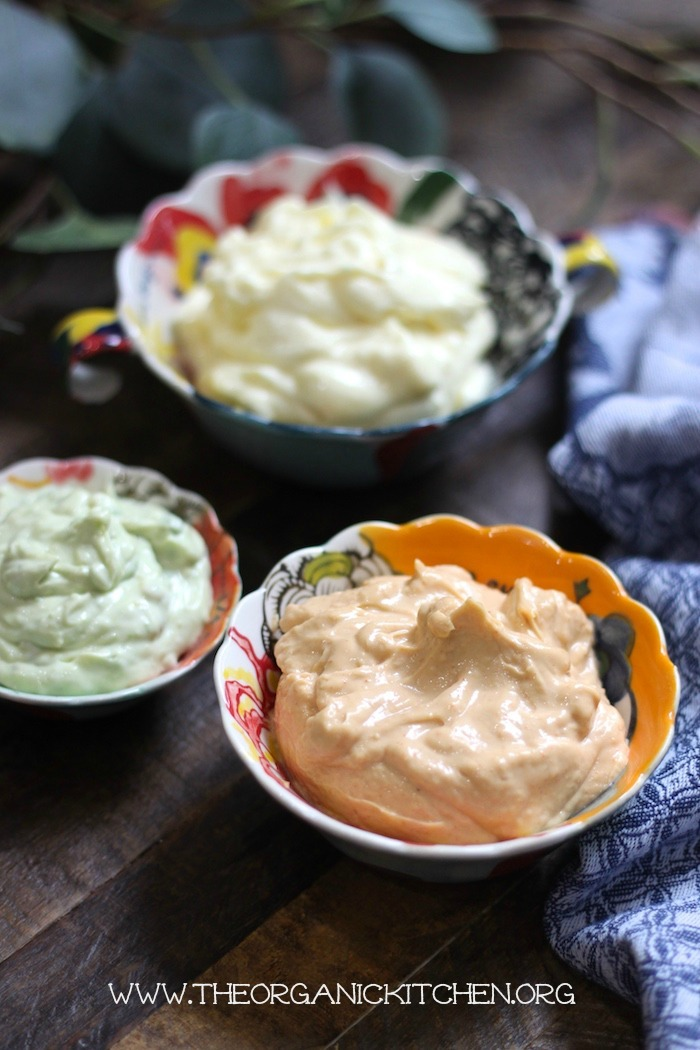 Three small bowls of mayonnaise for Salmon with Corn Hash and Chipotle Lime Mayo