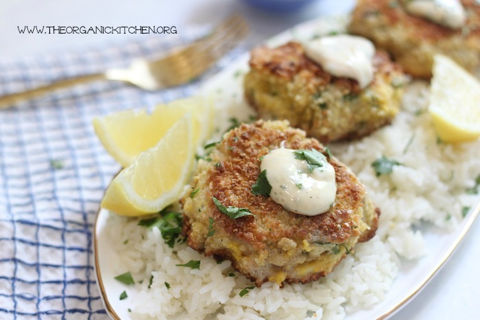 Crisoy Crab Cakes on a bed of rice with gold fork