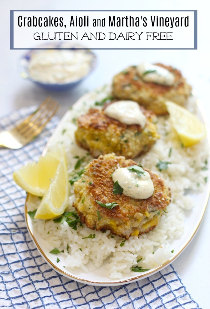 Crab Cakes with Aioli served on a platter on a bed of rice and lemon wedges