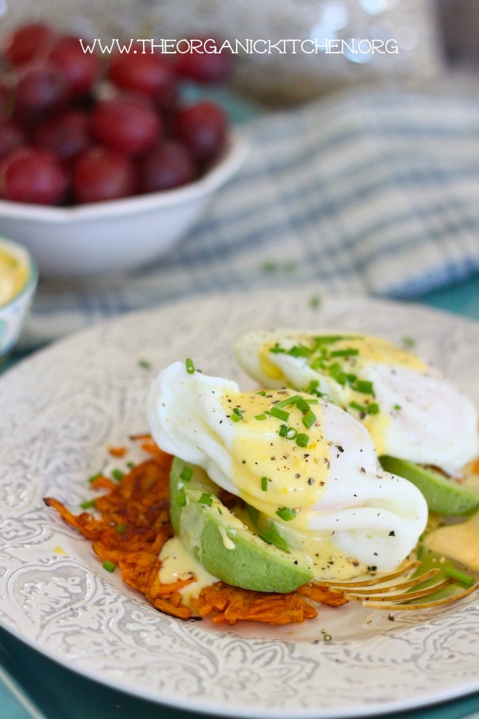 A sweet potato fritter topped with avocado, poached eggs and Hollandaise Sauce, one of 12 Healthy, Delicious (Whole 30) Breakfast Recipes!