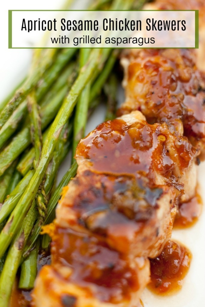 Apricot Sesame Chicken Skewers with Grilled Asparagus on white plate