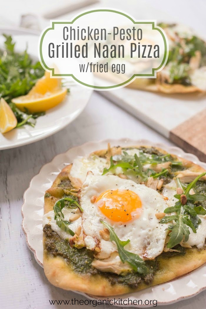 Chicken Pesto Burrata Naan Pizza with Fried Egg garnished with arugula on white plate