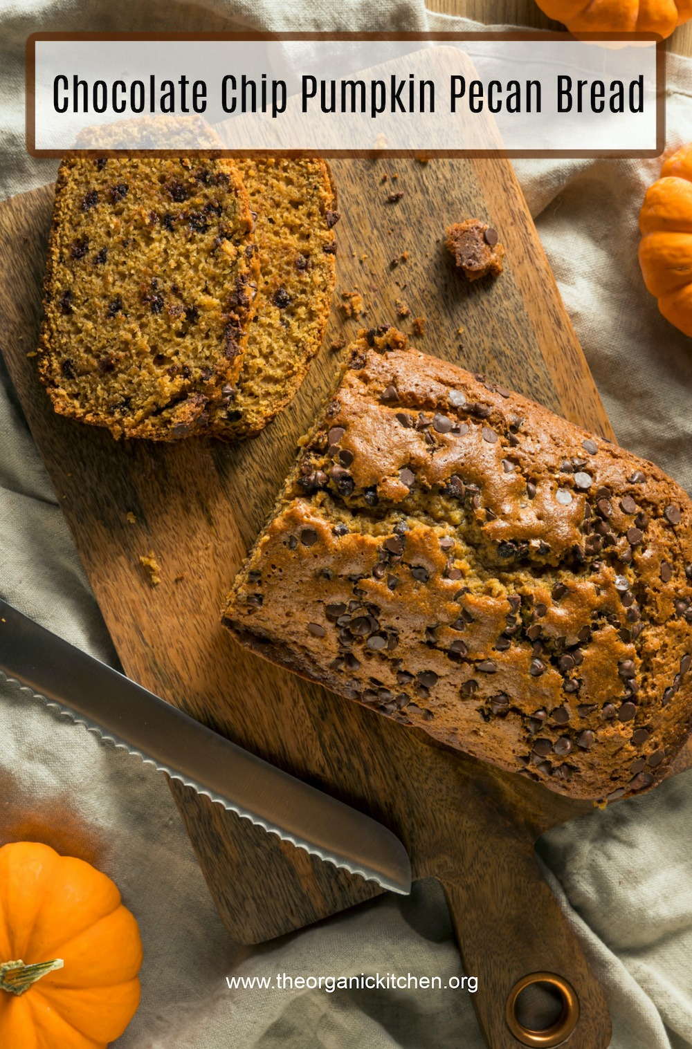 Chocolate Chip Pumpkin Pecan Bread (gluten free option) on wood cutting board surrounded by small pumpkins