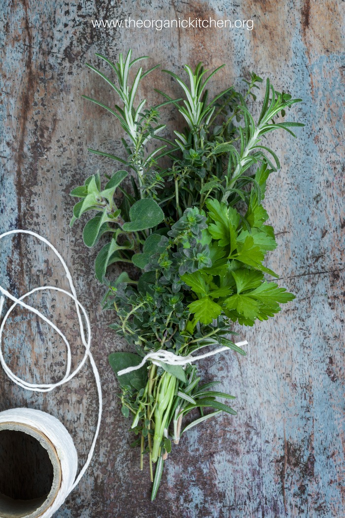 A bundle of herbs tied with string used for making Tender Braised Short Ribs