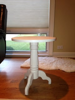 White end table placed in living room that is about to be transformed into a baseball table