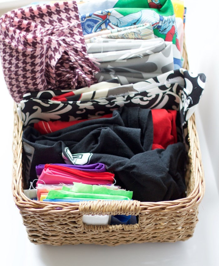 Basket full of colorful fabrics to show how to organize craft supplies. #fabric #organized