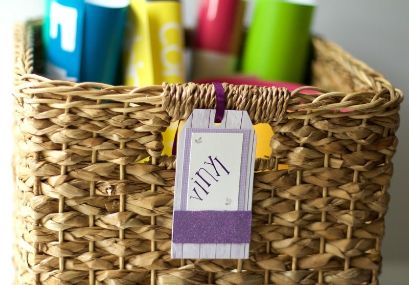 Woven basket labeled and filled with vinyl #organize #craftsupplies