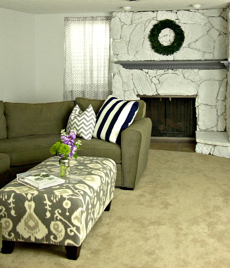 Couch Ottoman and Fireplace