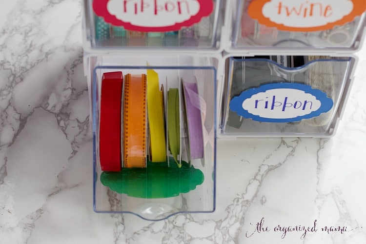 keep ribbons and other office supplies organized with tilt bins.